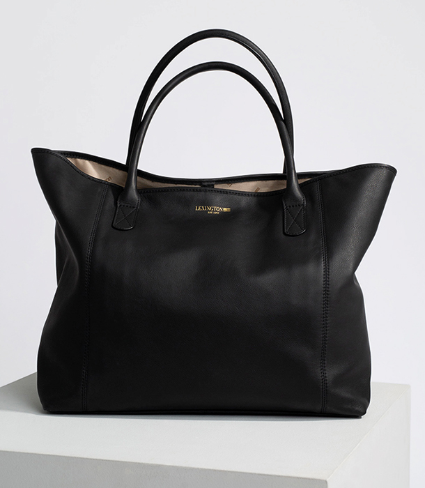 The wish-list topping Black Willow bag shows that classic simplicity rules. In line with our values, the Black Willow Tote is prepared with the mixture of Chrome and natural materials and without the use of chemical fertilizers, pesticides, or other artificial agents. Made from cow leather, it's a functional trophy tote that environmentally conscious consumers will wear loud and proud. The gold metal trims, and gold foil embossed logo give the bag a subtle sophistication.