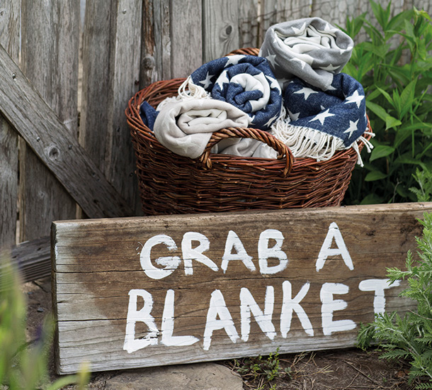 Be the best host you can be and keep a basket of blankets handy for guests who might get cold during a game of croquet.