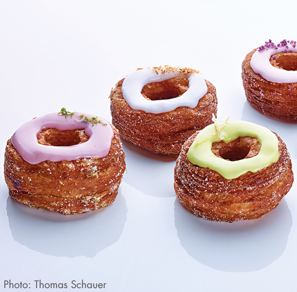 Made with a laminated dough, the Cronut®  takes three days to make. Once done, they're flavored in three ways: 1) rolled in sugar, 2) filled with cream, or 3) topped with glaze.