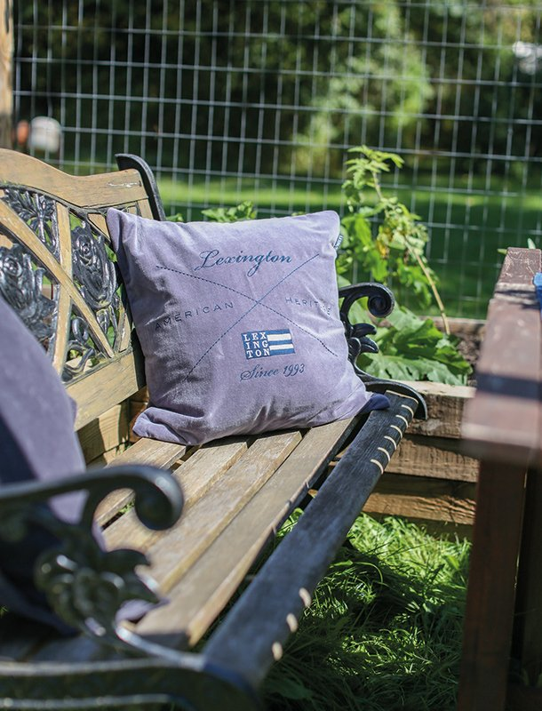 The benches in the backyard were also decorated with our shams and throws to make dining outside as comfortable as possible.