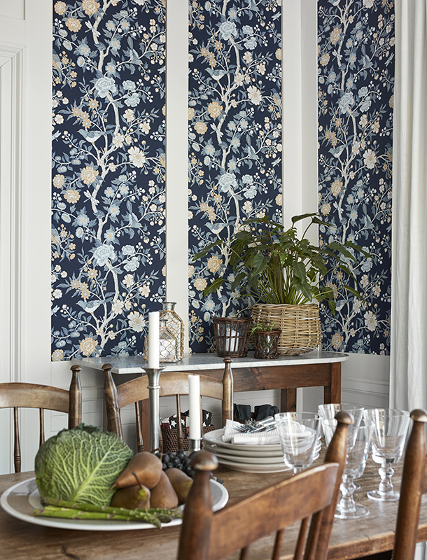 Here's a great example of a wallpaper that stops at hip-height. Like many of our wallpapers, the Emily wallpaper is named after one of America's foremost poets, Emily Dickinson. It's inspired by a fragment of old Cretonne-patterned wallpaper found in a New England archive. Bold tree patterns with birds like these were popular in the American home during the late 1600s.
