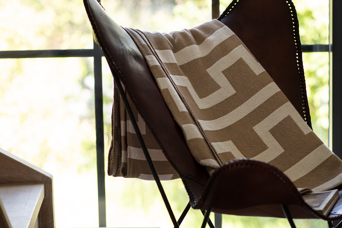 """This soft and lovely blanket in recycled cotton has a timely graphic design, which I love,"" Kristina says."