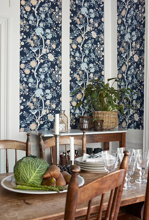 The Emily Wallpaper is inspired by a fragment of old Cretonne-patterned wallpaper found in a New England archive. Bold tree patterns with birds like these were popular in the USA in the late 1600s.
