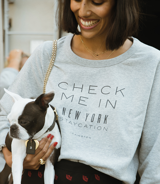 Babba Rivera seen in our Staycation Sweatshirt.