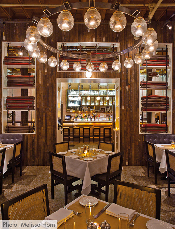 The restaurant is named after two 19th-century racehorses which is why you'll see equestrian themed decor like the wagon wheel chandelier at Saxon & Parole.