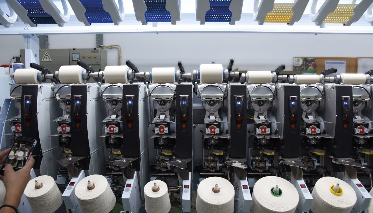 When the yarns, which are spun on paper bobbins, arrive to the vertical mills they're respun on plastic bobbins with holes that allow the dye to permeate the yarn.