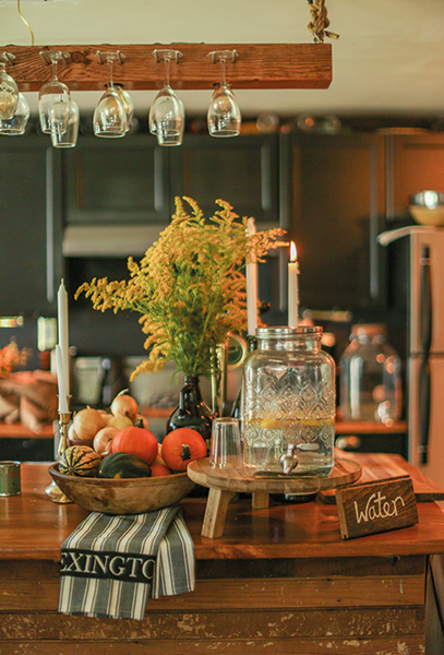Yellow and orange colors were repeated in the kitchen were guests found some refreshments.