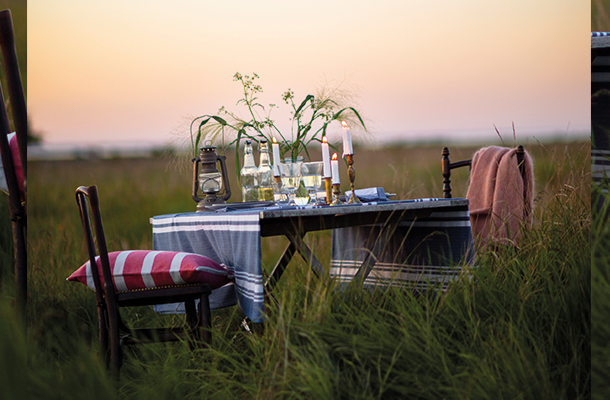 Instead of a huge centerpiece, go with wild flowers for your table. It goes well with the glamping theme.